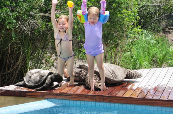 Children having poolside fun on their Mozambique holiday.