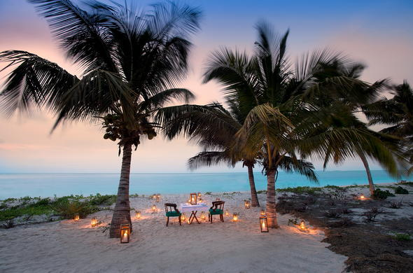 Romantic dinner on the beach on Benguerra Island, Mozambique.