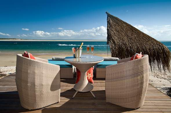 Enjoy exquisite views and glasses of champagne on the beach deck.