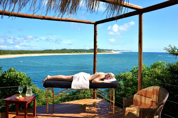 Guest being spoiled with spa treatments at Machangulo Beach Lodge.