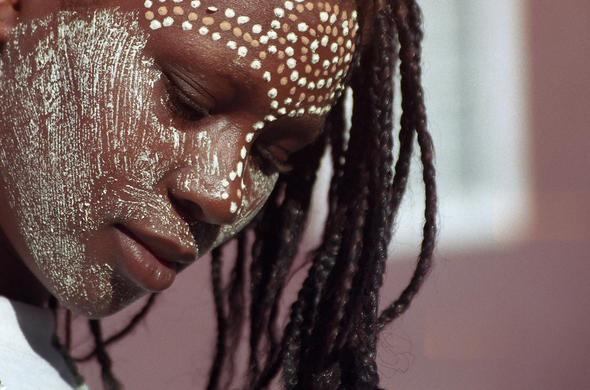 Makonde woman with face paint.