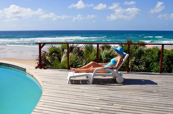 77e66a25c68bf6 Massinga Beach pool deck leisure with beach views.