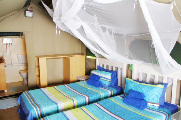 Twin bedrooms with mosquito nets at Serenity.